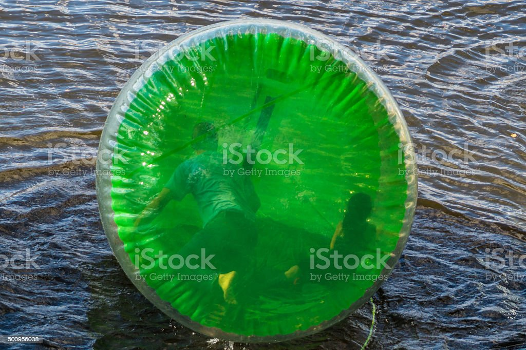 man and girl Zorb Inside Large  Balls On Water stock photo