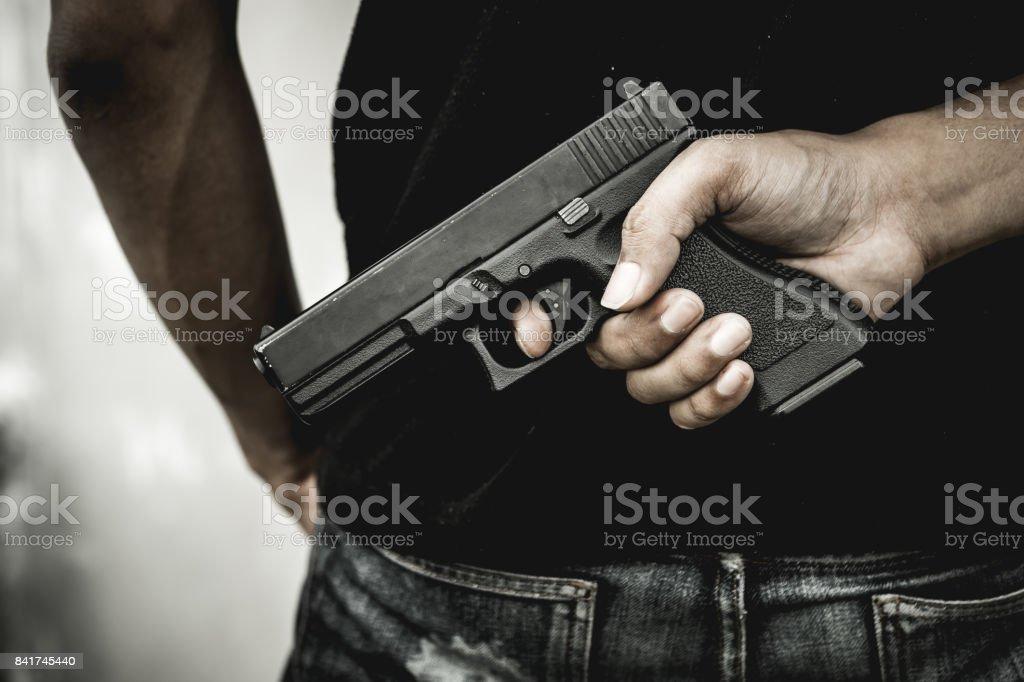 Man and gun. stock photo