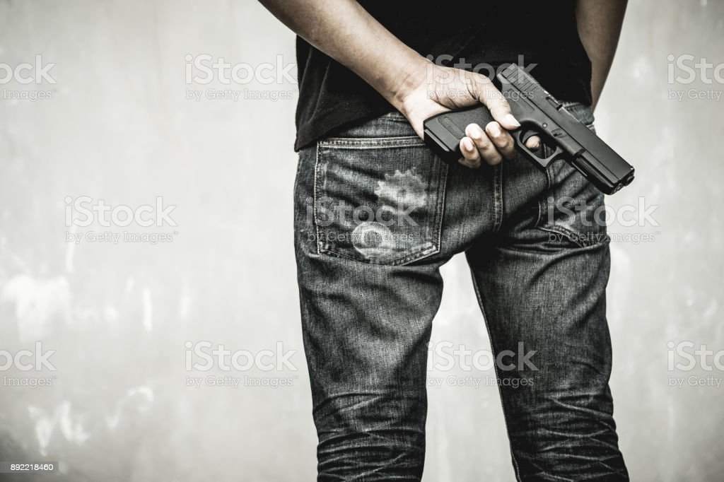 Man and gun. stock photo