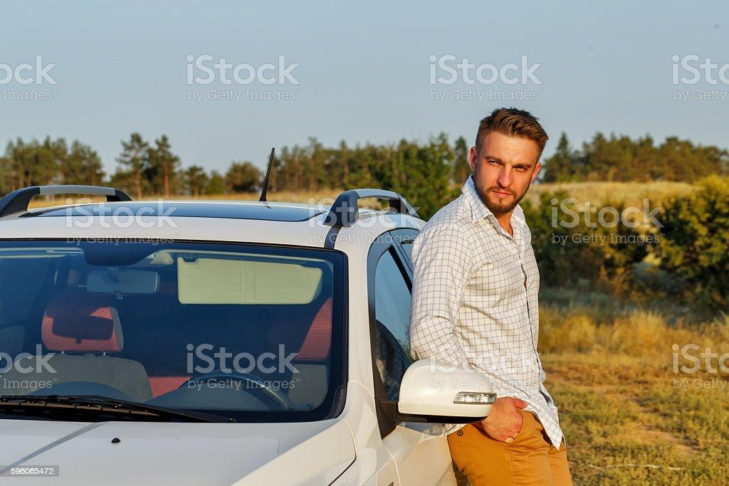 Man and his car royalty-free stock photo