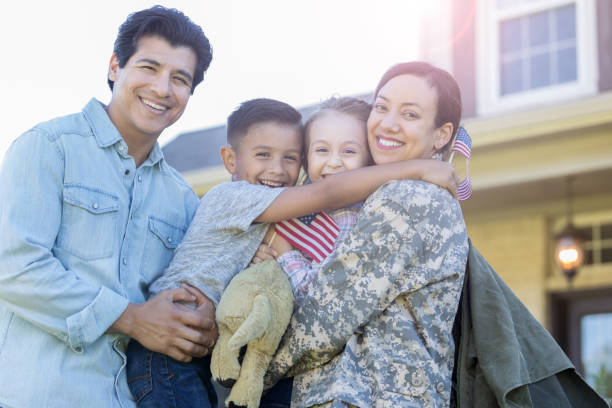 man and his children are reunited with military mom - tropa imagens e fotografias de stock