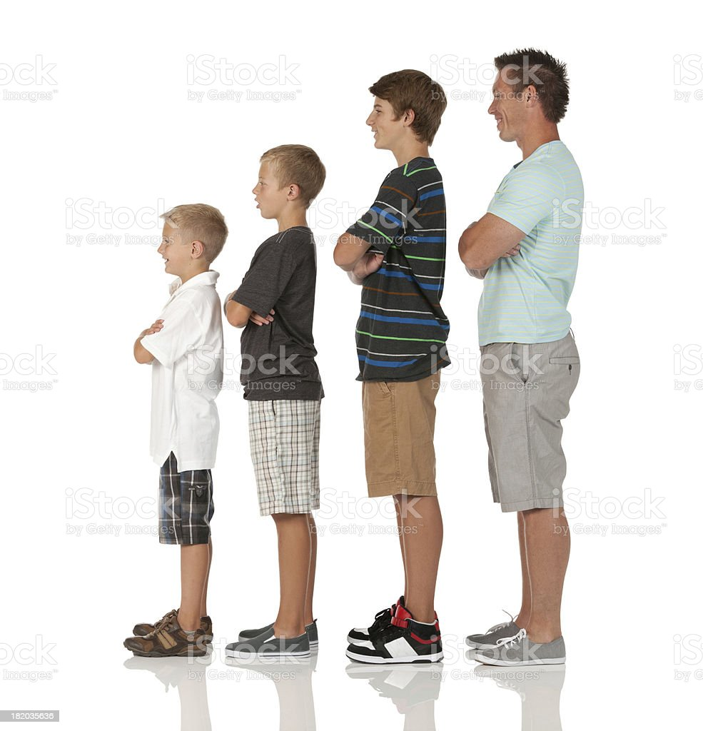 Man and his children standing in ascending order stock photo