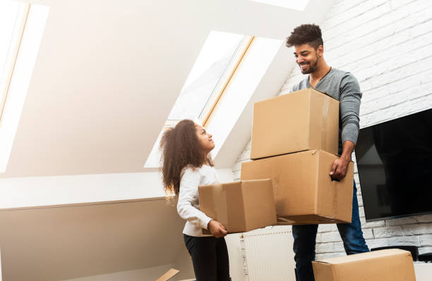 Man and his daughter moving into their new home stock photo