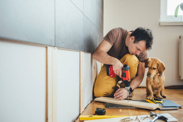 man and his dog doing renovation work at home - hundezubehör diy stock-fotos und bilder
