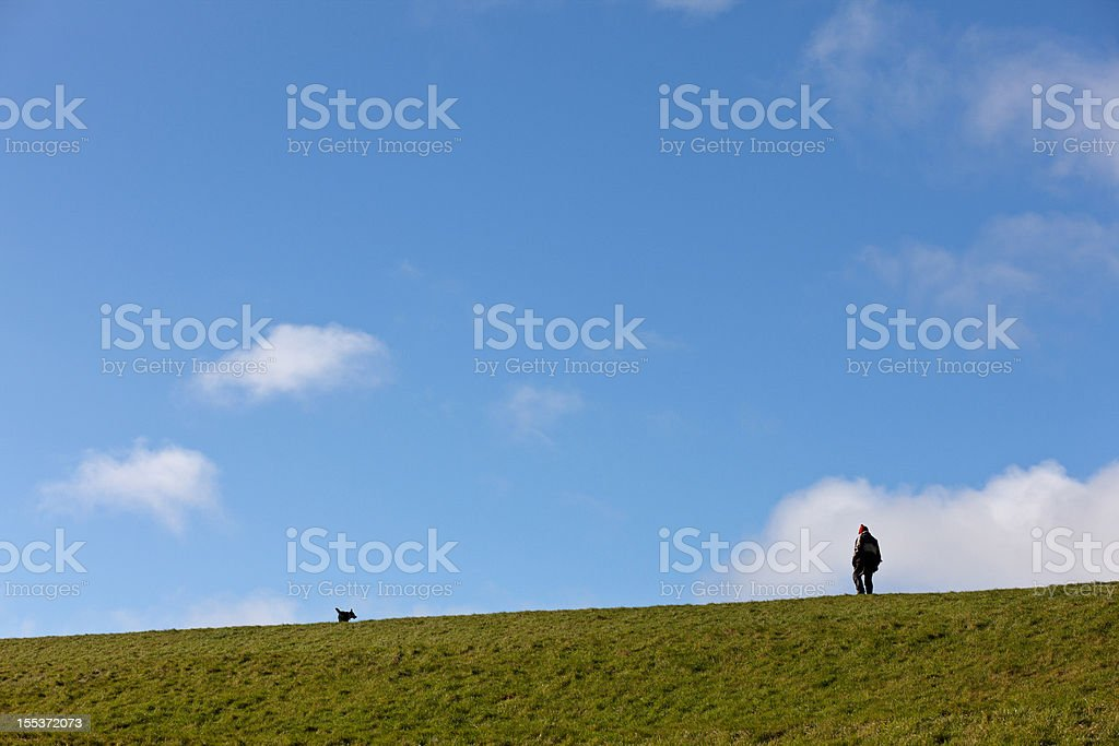 Man and his dog out walking royalty-free stock photo