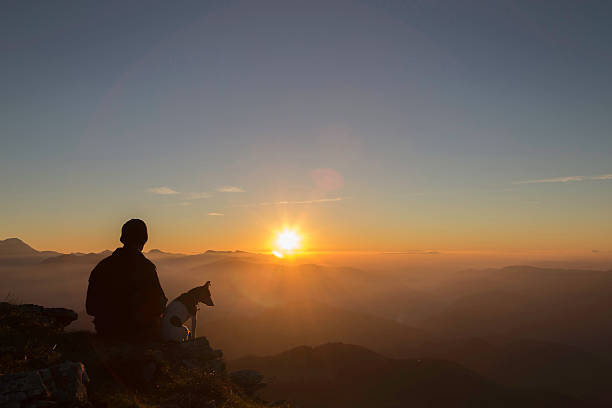 Man and his dog watching the sunset picture id589441560?b=1&k=6&m=589441560&s=612x612&w=0&h=nicitinvpgrvqjcgvpyzoq853e6 ynjju20hsxd1r4u=