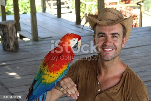 Man and his domesticated parrot.