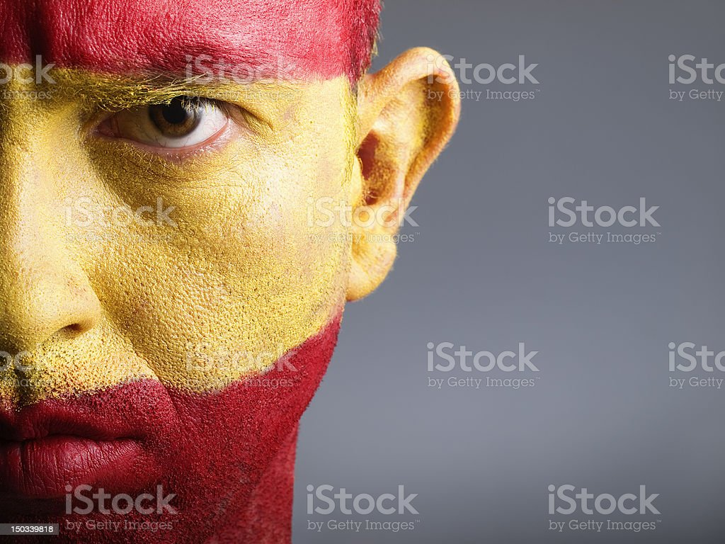 Man and his face painted with the Spain flag stock photo