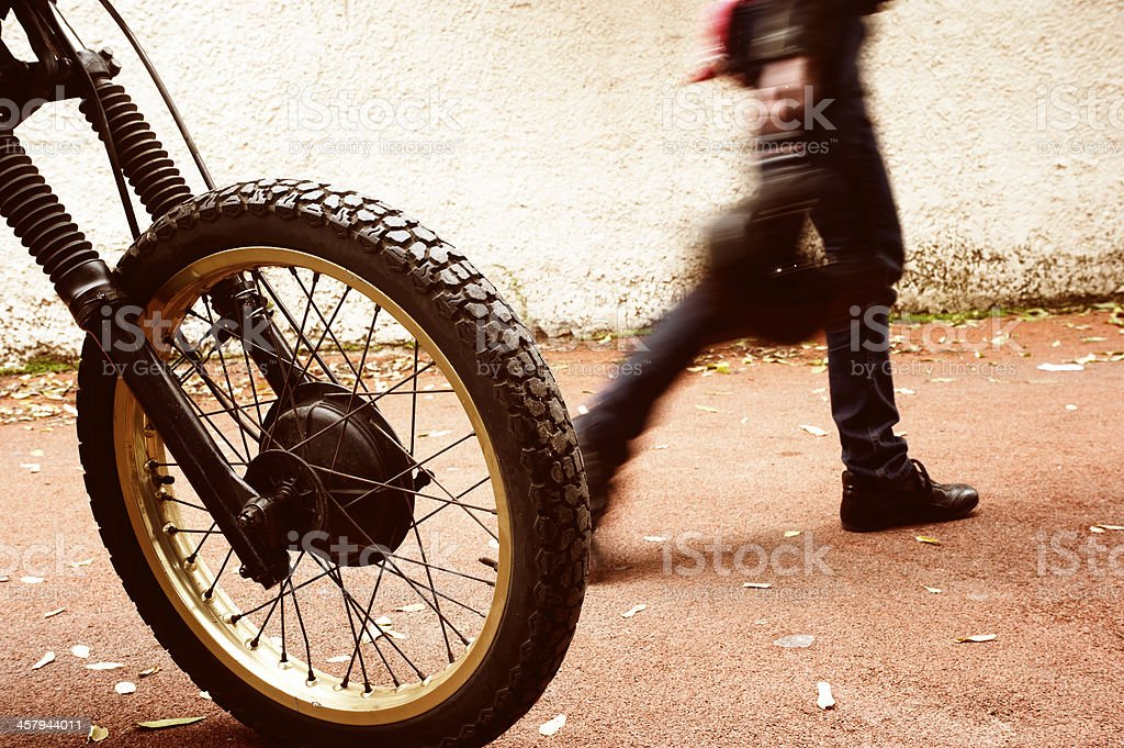 Man and his motorcycle royalty-free stock photo