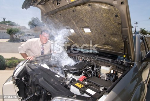 istock Man and his over heated car 93233060