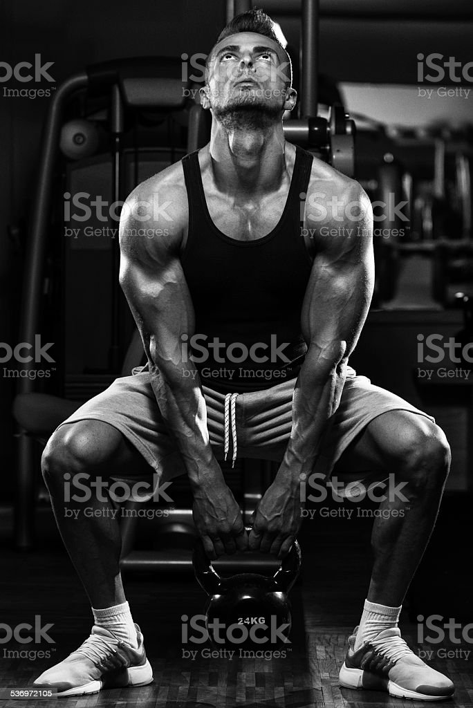 Man And Kettle Bell stock photo