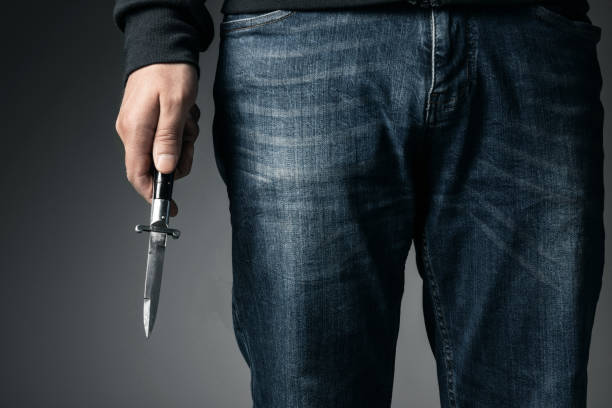 Man and knife Man and knife switchblade stock pictures, royalty-free photos & images