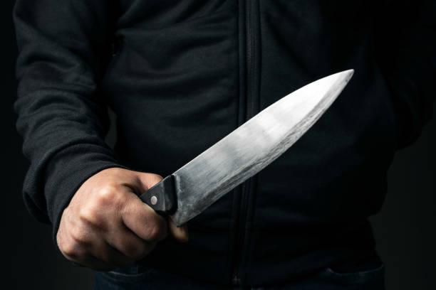 Homme et couteau - Photo