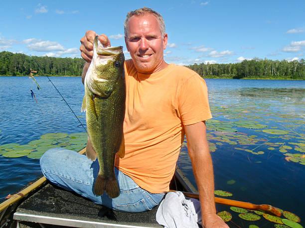 Man and Largemouth Bass stock photo