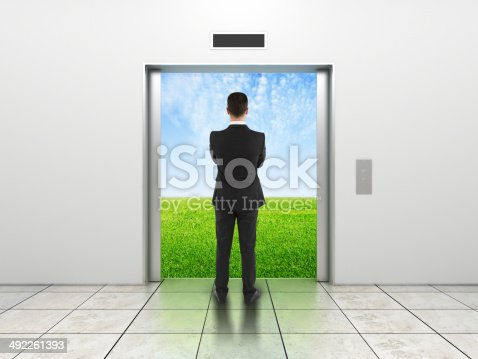 638591126 istock photo man and modern elevator 492261393