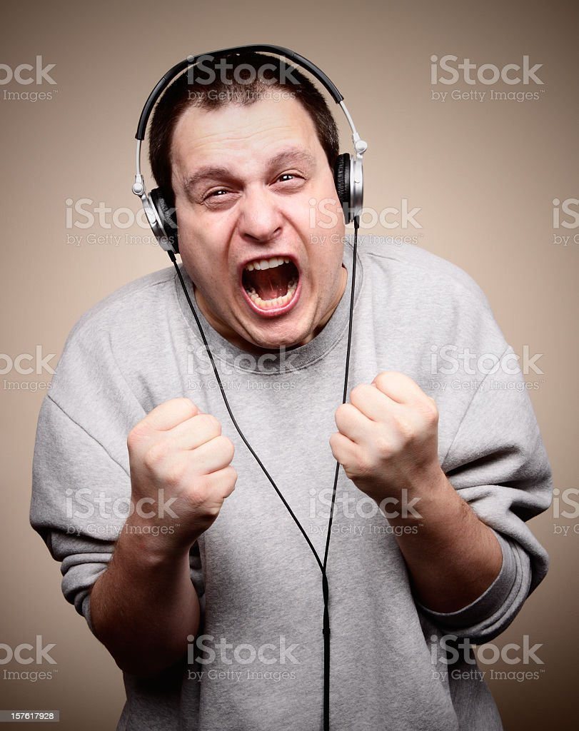 An angry white man, listening to music.