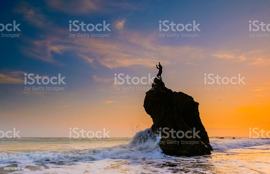 man and ocean sunset stock photo