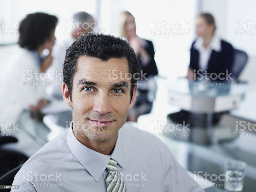 Man and office colleagues in a boardroom meeting stock photo