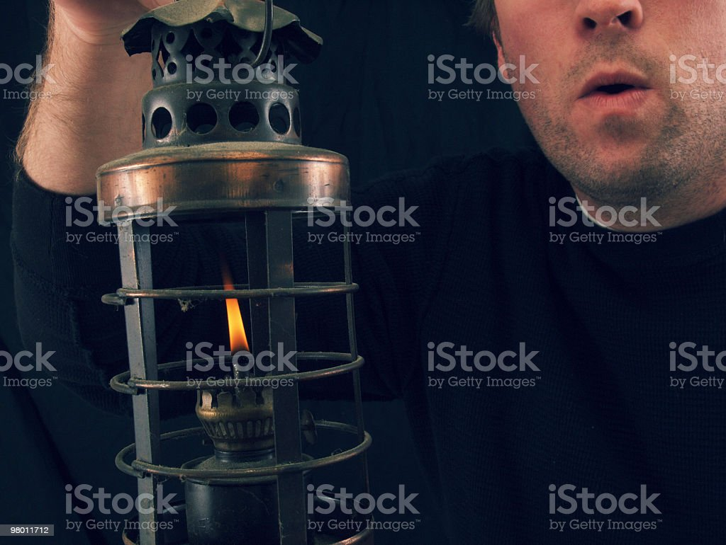 Man and Oil Lantern royalty-free stock photo