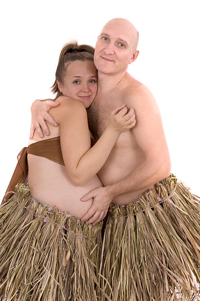 Man and pregnant woman in a dress made of straw - foto de stock