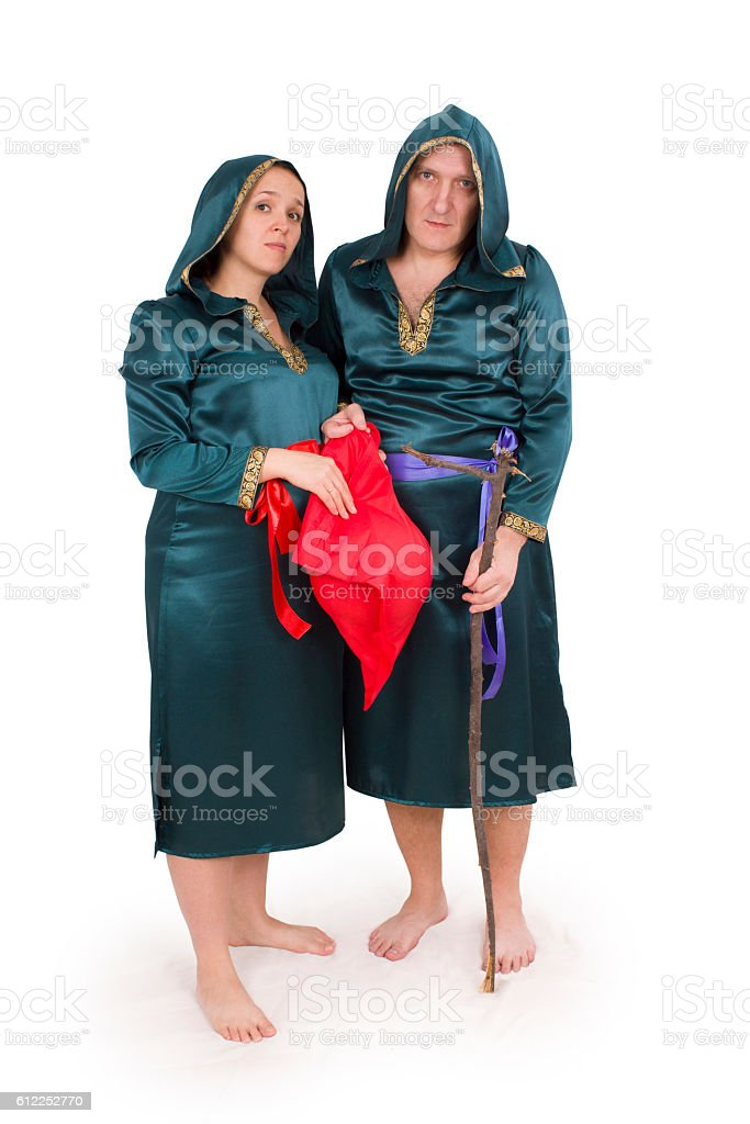 Man and pregnant woman in carnival costumes (Clipping path) stock photo