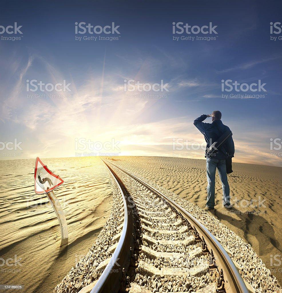 Man and railway in desert stock photo