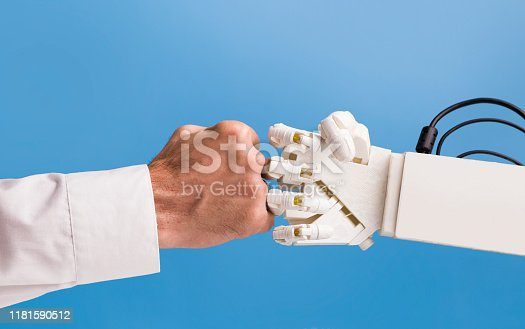 1050855372 istock photo Man and robot hands making fist bump gesture 1181590512