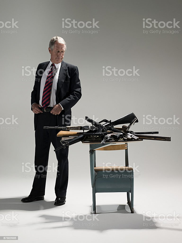 Man and schoolgirl with guns royalty-free stock photo
