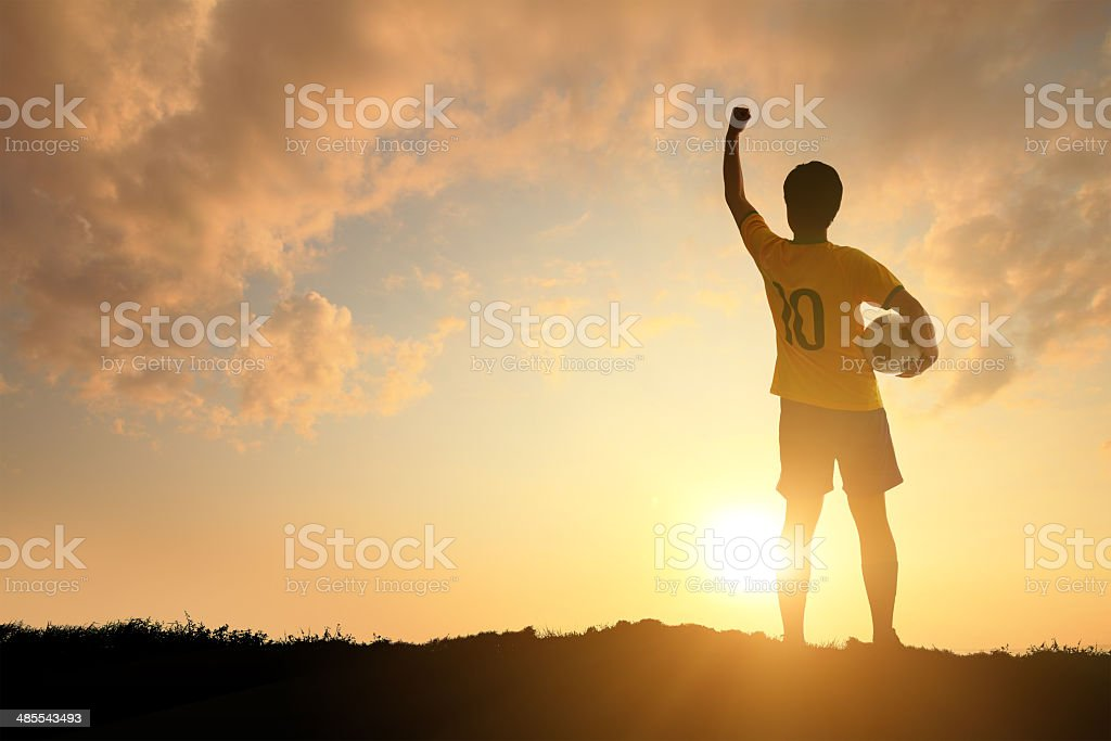 Man and soccer silhouette stock photo