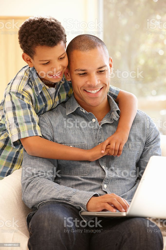 Man and son working together on laptop royalty-free stock photo
