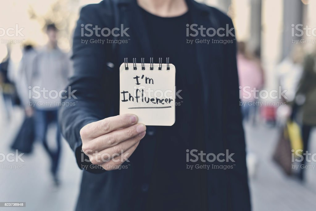 man and text I am influencer in a note stock photo