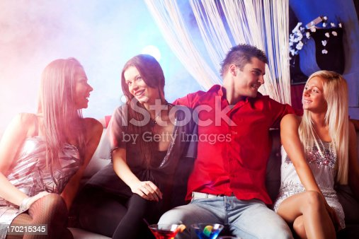 istock Man and three women talking at the disco. 170215345