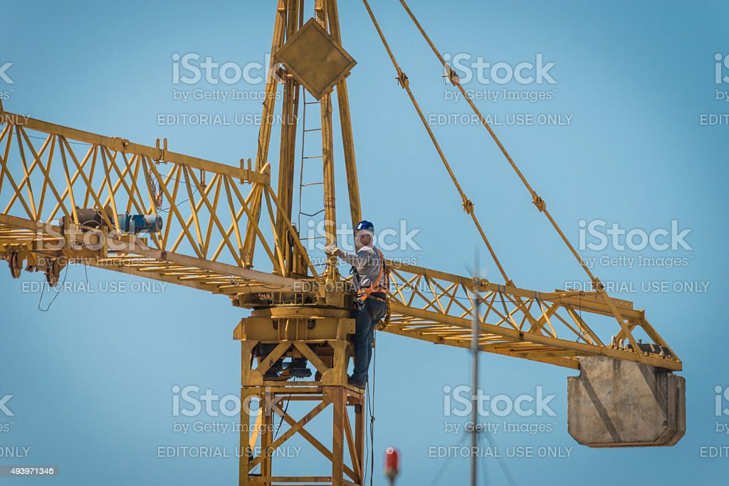 Man and Tower Crane stock photo