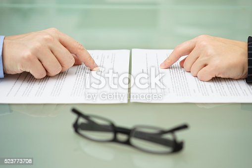 istock man and wife are reading divorce agreement 523773708