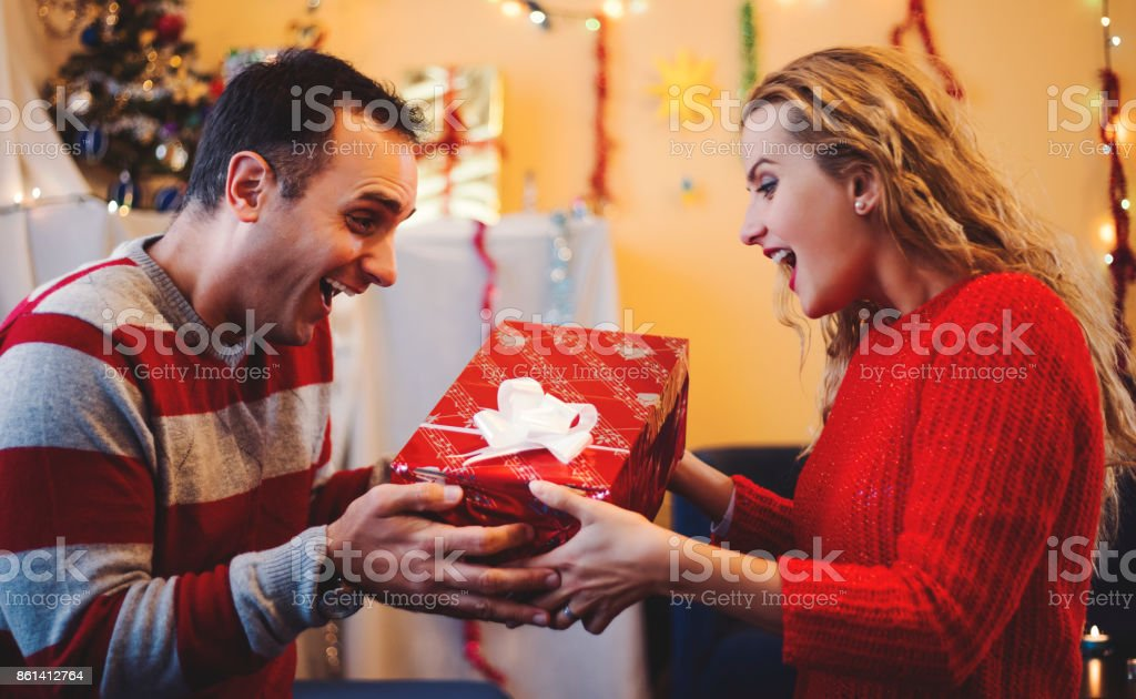 Man and wife spend Christmas together stock photo