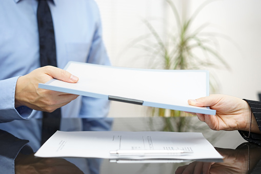 istock Man and woman are exchanging contract or document 534921031