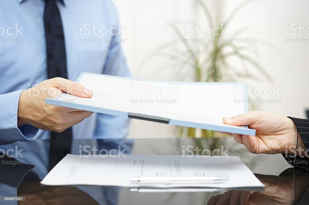 Man and woman are exchanging contract or document stock photo