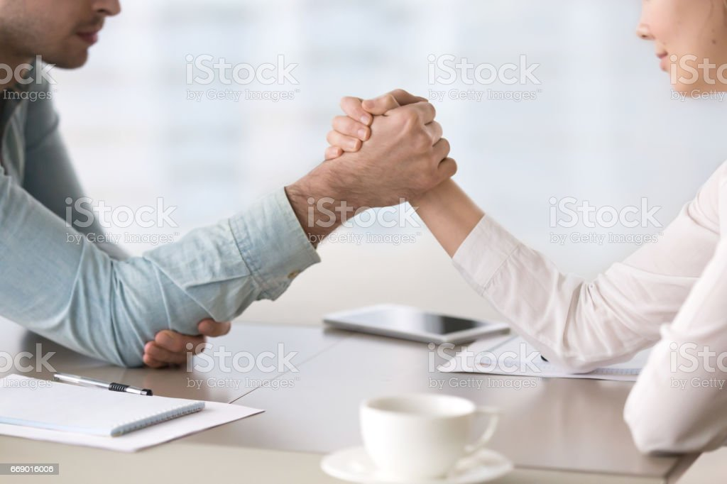Man and woman armwrestling, business competition and gender equality concept stock photo