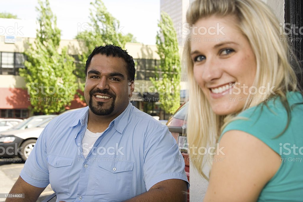man and woman at an outside table (focus on guy) royalty-free stock photo