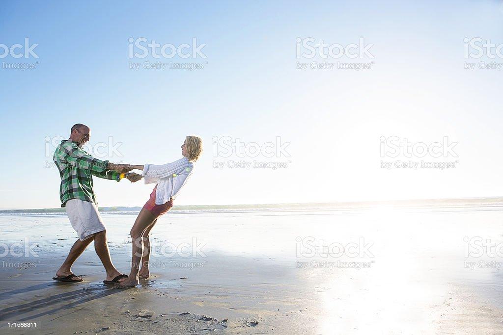Man and woman at beach royalty-free stock photo
