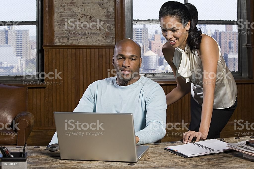 Man and woman at desk royalty-free stock photo