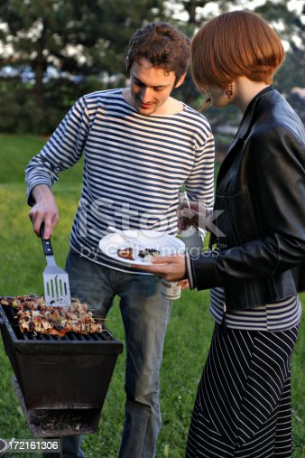 696841580istockphoto Man and Woman Barbecuing, Barbecue 172161306