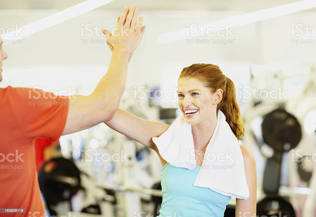 Man and woman celebrating success at gym royalty-free stock photo