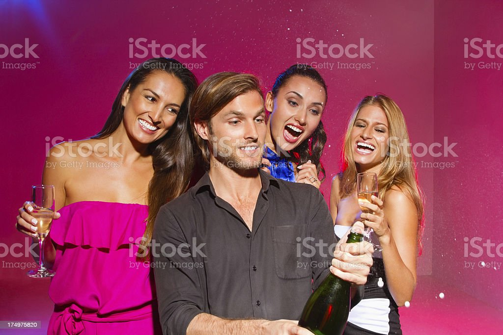 Man And Woman Celebrating With Drinks royalty-free stock photo