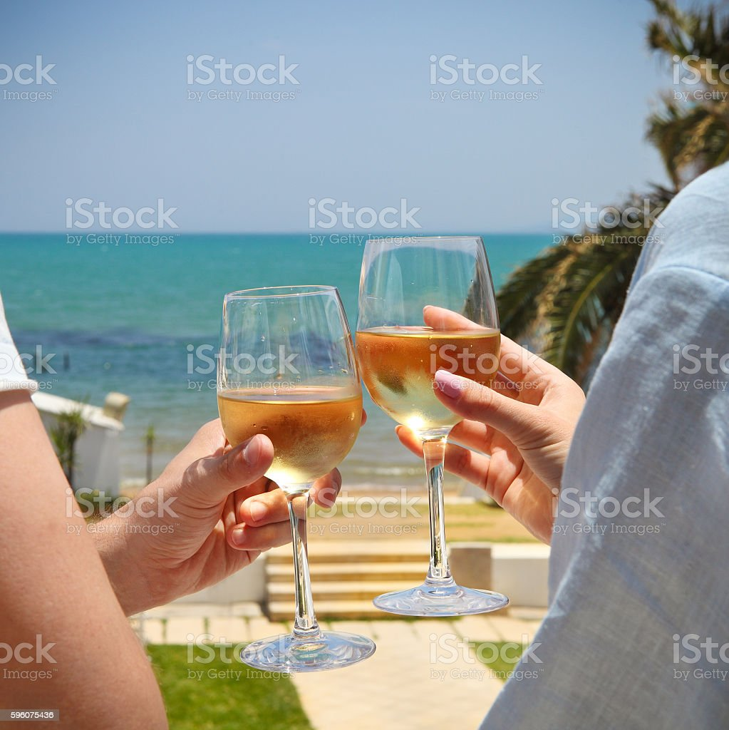 Man and woman clanging wine glasses royalty-free stock photo