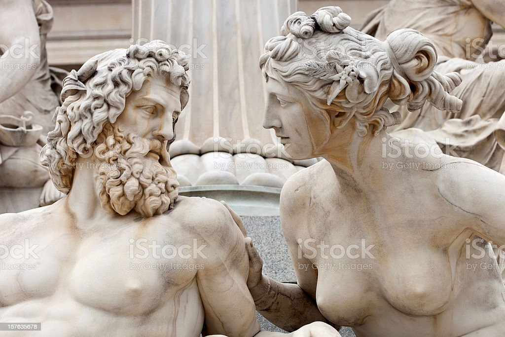 Man And Woman Conversing The Atena Statue In Vienna, Austria stock photo