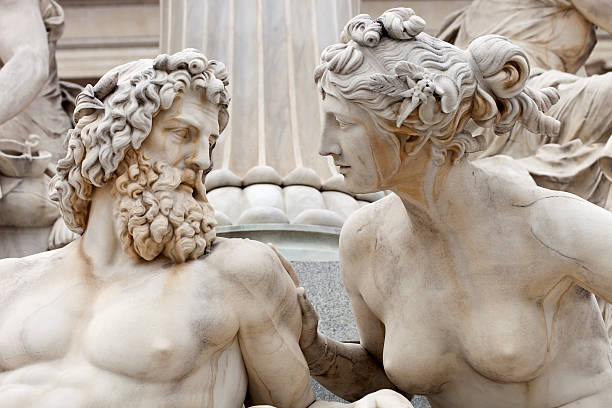 Man And Woman Conversing The Atena Statue In Vienna, Austria stock photo