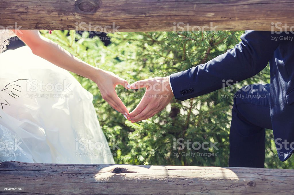 Man and woman couple holding hands on a romantic stock photo