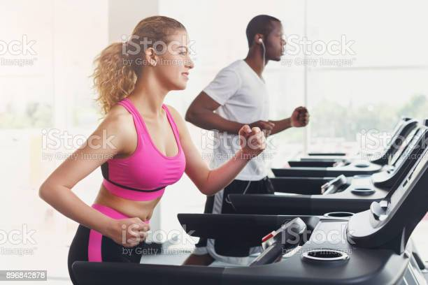 Man and woman couple in gym on treadmills picture id896842878?b=1&k=6&m=896842878&s=612x612&h=zxh86q0vofzsz8vffqkoqfsnee0j6aydh3n4bghdgdg=