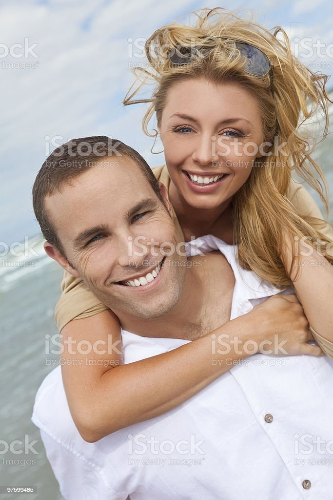 Man and Woman Couple In Romantic Embrace On Beach royalty-free stock photo